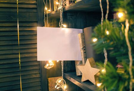Festive still life with a blank white sheet as a template for an inscription Imagens