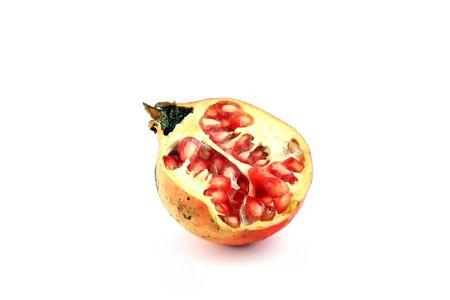 pomegranat: half of pomegranate on white bacjground