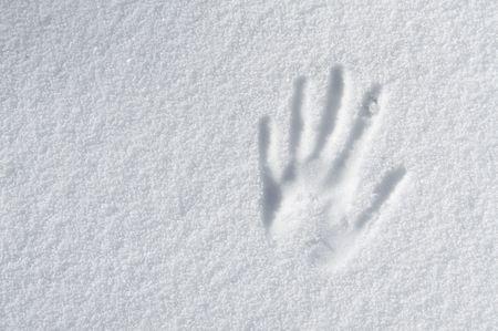 hand impression in fresh snow photo