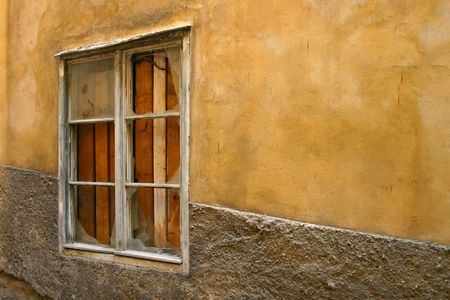 spotted wall with window on alleyway photo