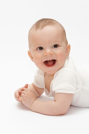 laughing baby: Laughing baby lying on the floor