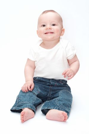baby sitting: smiling baby sitting on the floor Stock Photo