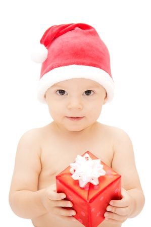 baby in santa claus cap with gift photo