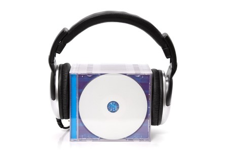 headphones with stack of cds photo