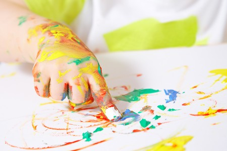 messy paint: painting baby hand Stock Photo