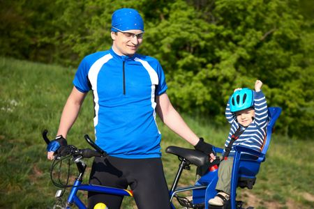 father with son in bicycle chair photo