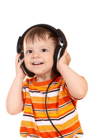 listening to people: smiling baby with headphones Stock Photo