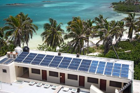 isla: birdeye view on the beach with a building with a solar panel on the Isla Contoy, Mexico Stock Photo