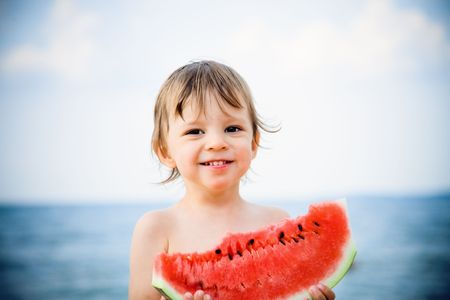 boy eating watermelon photo