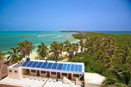 birdeye view on the beach with a building with a solar panel on the Isla Contoy, Mexico photo