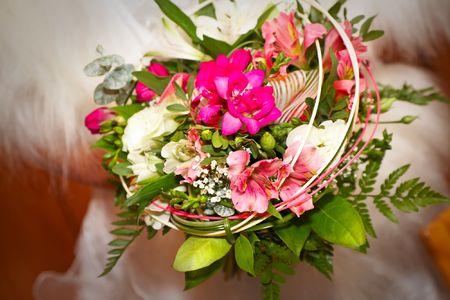 frock coat: bride holding her wedding bouquet
