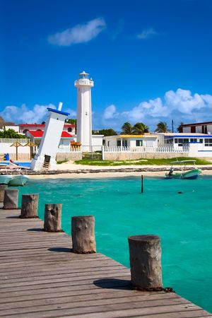 mayan riviera: old tilted and new lighthouses in Puerto Morelos near Cancun, Quintana Roo, Mexico