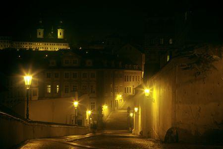 night alley in fog, Prague, Czech Republic photo