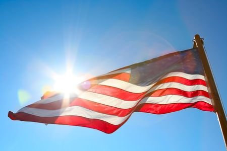 backlit: american flag backlit from the sun Stock Photo