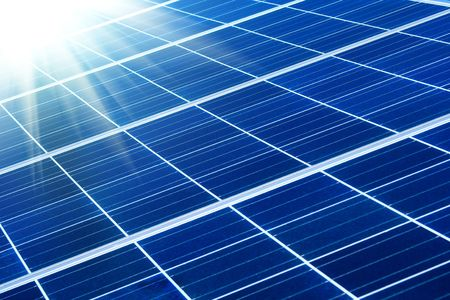 photovoltaic panel: solar panel with sunbeams Stock Photo