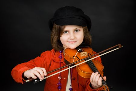 Girl practicing the violin photo