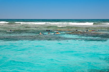 seaway: people snorkeling in the open sea Stock Photo