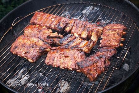 grilled pork ribs on bbq grill (shallow DOF) photo