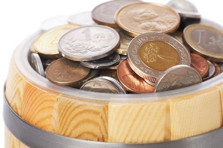 overflowing barrel with various coins photo