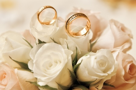 wedding rings with bouquet photo