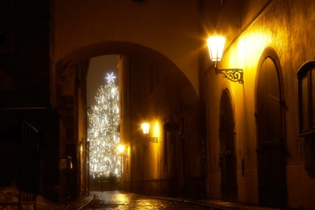 mysterious narrow alley with christmas tree in Prague photo