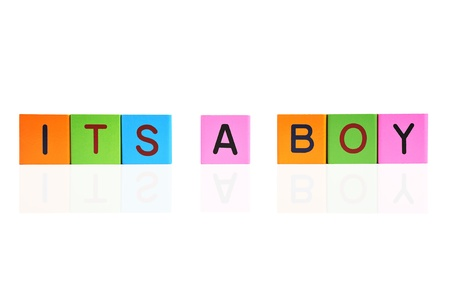 its a boy: phrase ITS A BOY formed with wooden letter blocks Stock Photo