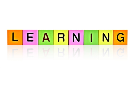 word LEARNING formed with wooden letter blocks photo