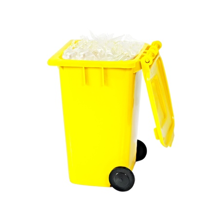 full yellow recycling bin with plastic photo