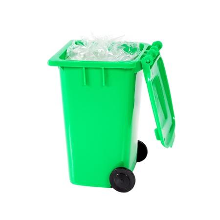 dustbin: full green recycling bin with plastic