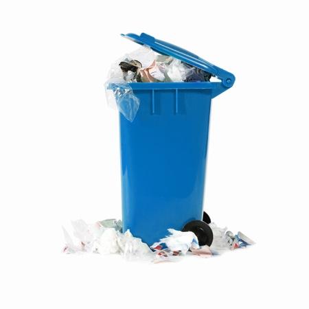 garbage can: overflowing blue garbage bin Stock Photo