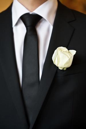 tux: white rose on the suit of groom Stock Photo