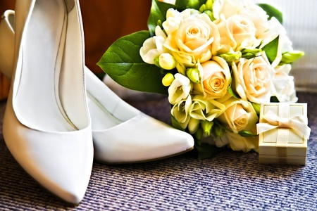 box with a wedding rings with bouquet and high heel shoes