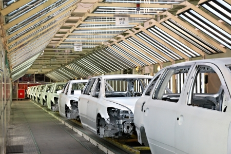 domestic production: cars in a row at car plant Editorial