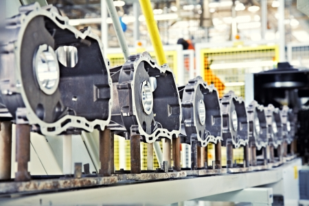 factory automation: manufacturing parts for engine Stock Photo