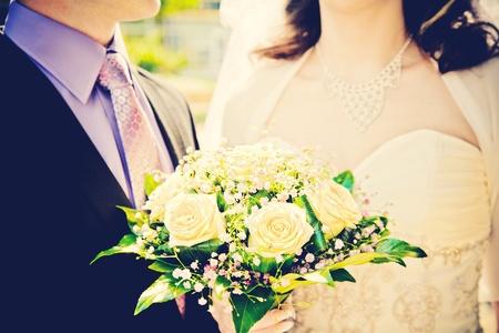 frock coat: bride and groom with wedding bouquet