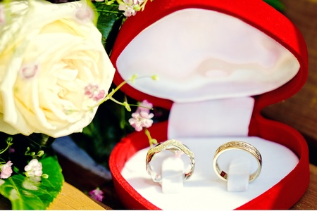 unity small flower: wedding rings in the boxes with a shallow DOF Stock Photo