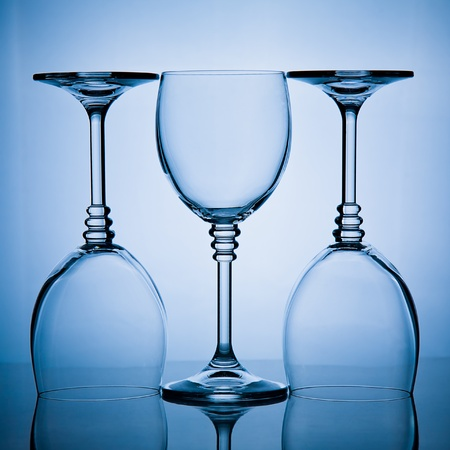 goblet: blue toned shot of a  three wineglasses in a row