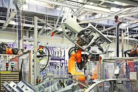 자동차 공장에서 로봇 팔 스톡 콘텐츠