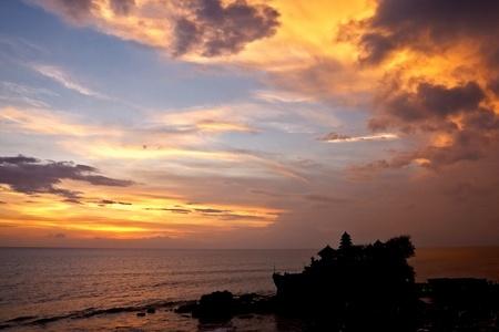 sunset over hindu temple Tanah Lot, Bali photo