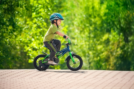 bike riding: boy in a helmet riding bike