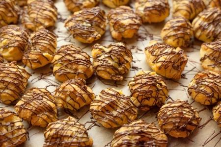 cream puff: eclair dessert with chocolate decoration