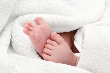 baby feet in towel Stock Photo