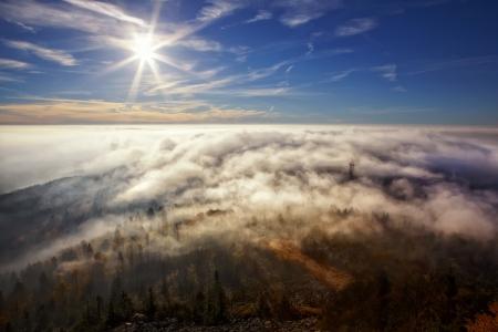 inversion: view on the sun over inversion from Jested, Jested-Kozakov ridge, Czech Republic