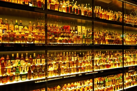 whiskey glass: EDINBURGH, SCOTLAND - JULY 10:  Diageo Claive Vidiz collection, the largest Scotch Whisky collection in the world on July 10, 2012 in Edinburgh, Scotland, UK Editorial