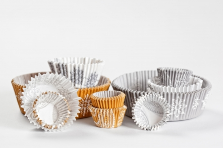 molds: baking paper cups for cupcakes or muffins Stock Photo