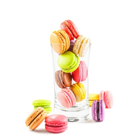 sweet pastries: traditional french colorful macarons on white background