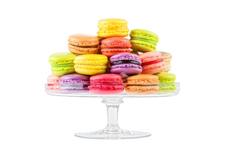 french food: traditional french colorful macarons in a glass cake stand on white background Stock Photo