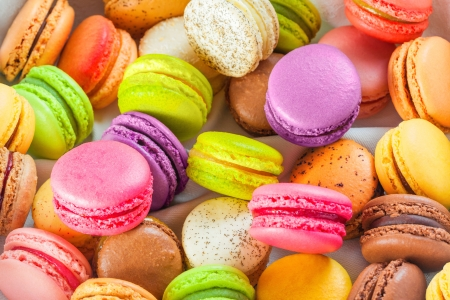 sweet pastries: traditional french colorful macarons in a box