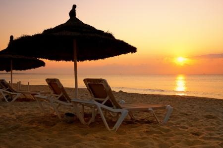 sunrise over the parasol on the beach, Tunisia