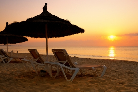 sunrise over the parasol on the beach, Tunisia